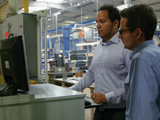 Mr. Northington (Jacob Plastics GmbH) and Mr. Theilacker (Optris GmbH) during the set up of the camera and software